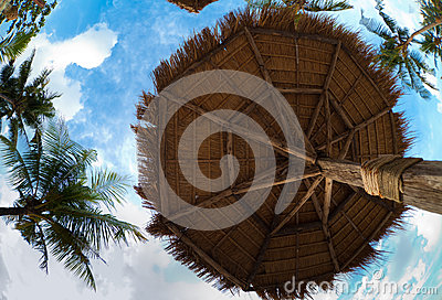 Umbrella made from palm leaves on tropical beach