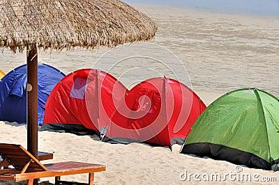 Umbrella and tent on seaside