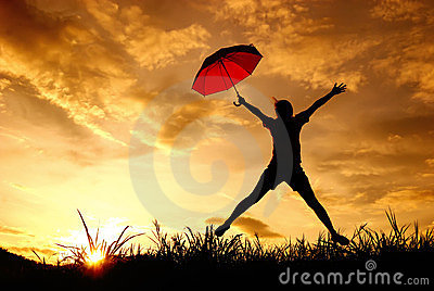 Umbrella woman jump and sunset silhouette in Lake