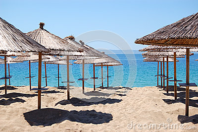Umbrellas on a beach and turquoise water