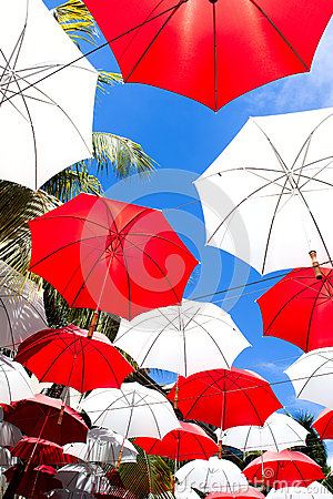 Umbrellas over sky background