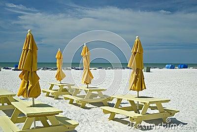 Umbrellas and picnic tables