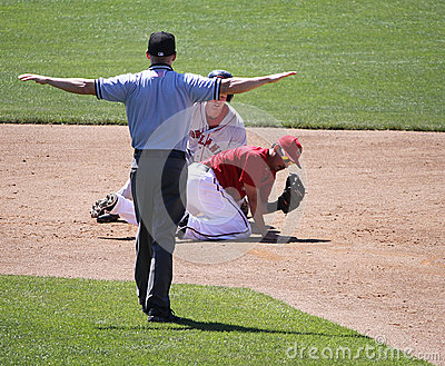 The umpire signals safe Editorial Stock Photo