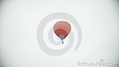 Un aerostato arancio che vola su un fondo del cielo nuvoloso bianco archivi video