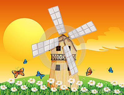 Un moulin vent en bois au jardin images libres de droits - Plan moulin a vent en bois pour jardin ...