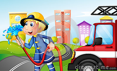 Un pompier avec un tuyau à la rue