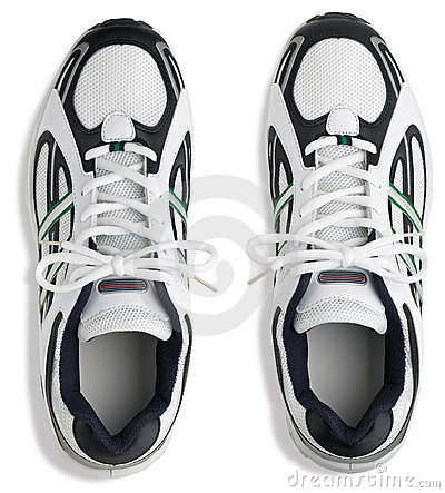 Unbranded pair of running shoes trainers on a whit