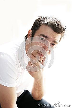 Uncertain man in white shirt