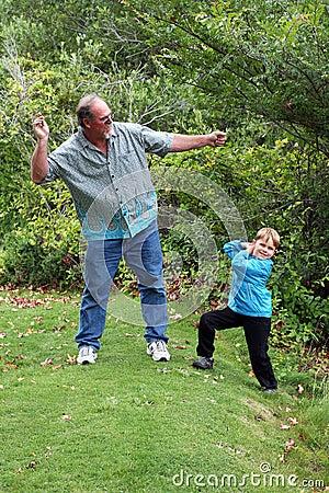 Uncle teaches nephew to skip stones