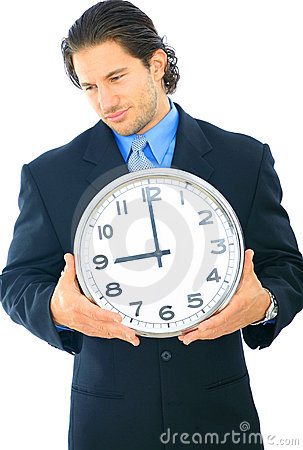 Uncomfortable Businessman Holding Clock