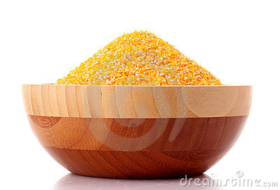 Uncoocked hominy grits  in bowl isolated