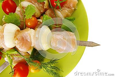 Uncooked chicken kebabs