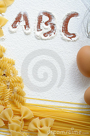 Uncooked macaroni and eggs on wheat flour