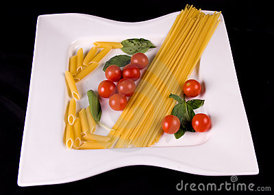 Uncooked pasta and tomatoes
