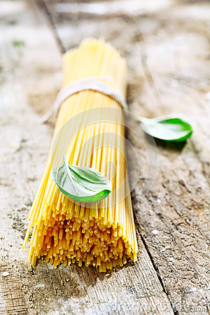 Uncooked spaghetti with basil