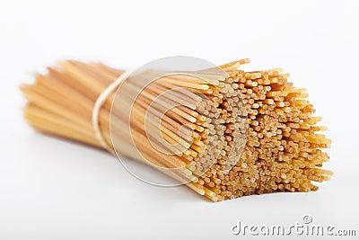 Uncooked spaghetti in a bundle