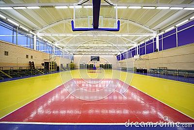 Under basket inside lighted school gym hall