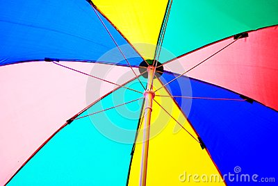 Under colorful beach umbrella