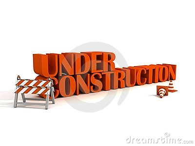Under constraction text with barrier and road traf