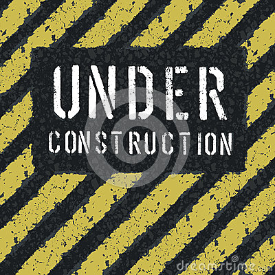 Under construction message on asphalt background