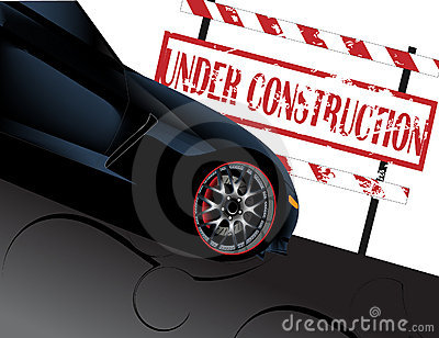 Under construction sign with corvette car