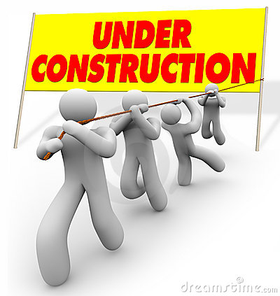Under Construction - Team Pulling Up Sign