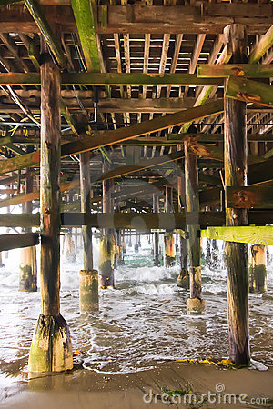Under a Fishing Pier along the Ocean