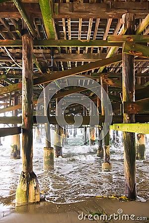 Under a Fishing Pier along the Ocean