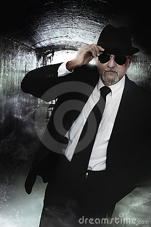 Undercover detective man in sunglasses