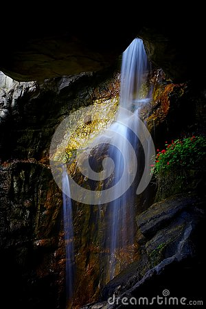 Free Underground Cave Waterfall Between Rock Formations Royalty Free Stock Photo - 144109645