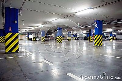 Underground parking garage with cars