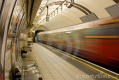 Underground train leaves Regents Park Station Editorial Photography
