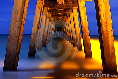 Underside of pier at night