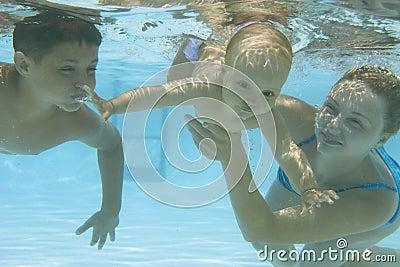 Underwater family in swimming pool