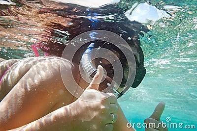 Underwater portrait of snorkeling woman