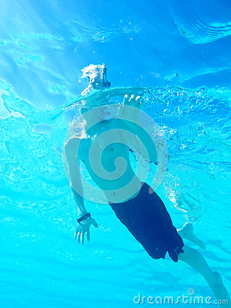 Underwater view of boy swimming