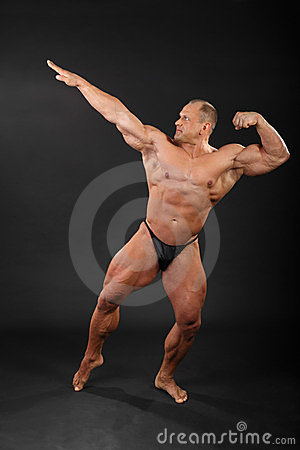 Undressed bodybuilder aiming for punch