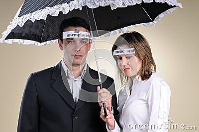 Unemployed people staying under umbrella