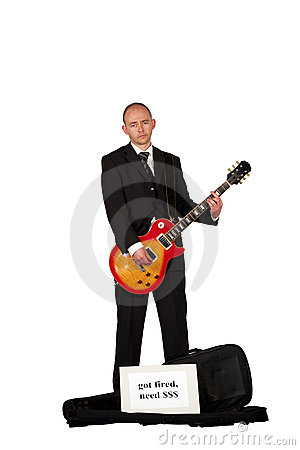 Unemployed playing guitar for money