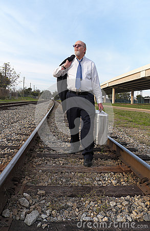 Unemployed Senior Businessman Walks Railroad Tracks