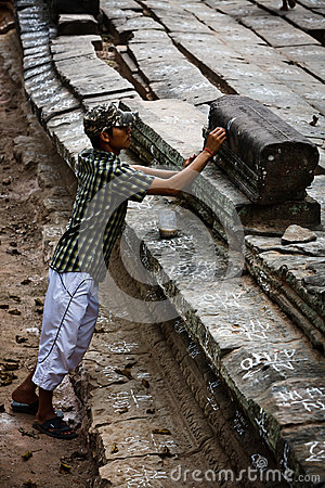UNESCO Restoration worker marks stones Angkor Wat Editorial Photography