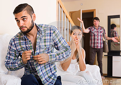 Unfaithfulness: blushed and looked away spouse caught by surpris Stock Photo