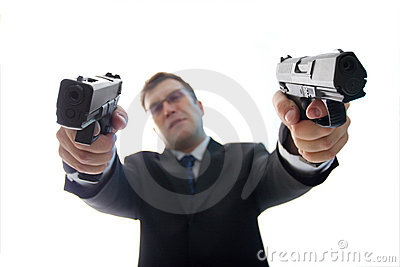 Unfocused criminal businessman with guns