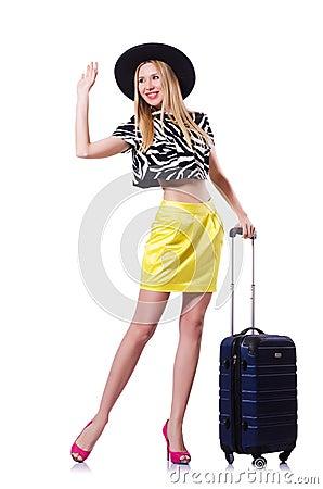 Ung kvinna med resväskan