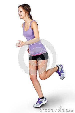 Ung kvinna som joggar över vit bakgrund