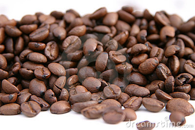 Unground coffee beans on a white background