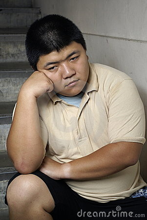 Unhappy asian man