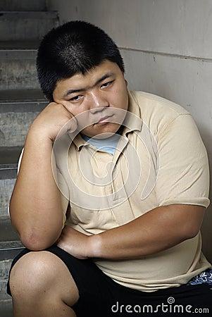 Unhappy asian man