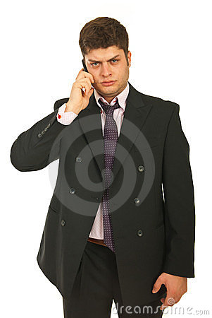 Unhappy business man by cell