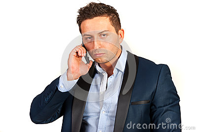 Unhappy business man on phone mobile